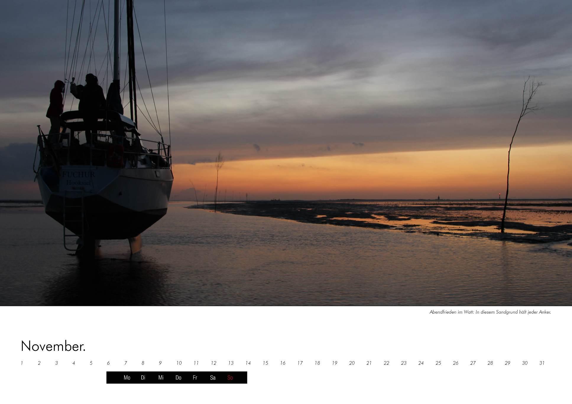 Kalenderbild eines Segelschiffs in den Abendstunden im Wattmeer